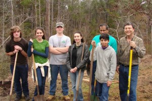 4-H members plant trees for a community service project during Arbor Day.