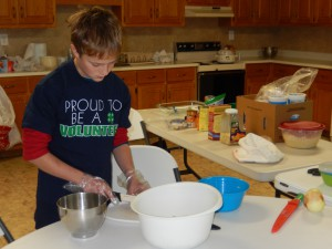 4-Her Isaac Brooks helped prepare meals for hospice patients as part of his 4-H Community Service Project.