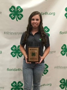 4-Her Jessica Wells accepted a Florida 4-H Community Pride Top 5 Project award on behalf of the Fire Ants 4-H Club at 4-H University.