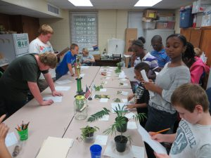 Leon County Master Gardeners help youth practice for the Horticulture Judging Contest.