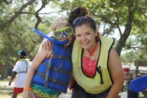 Youth in life jackets and snorkeling gear.