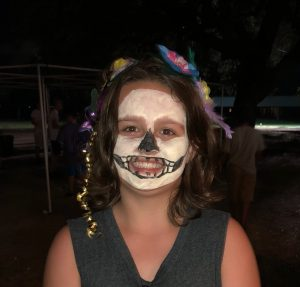Girl with face painted like a skeleton