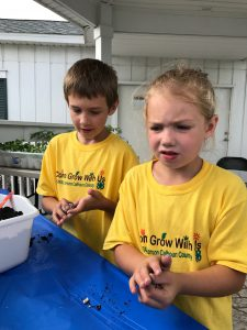 Two youth make wildflower seed bombs.