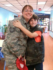 Child hugging his military parent