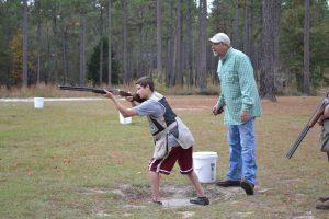 Youth shooting a skeet target.