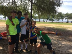 Five boys appear happy together at camp.