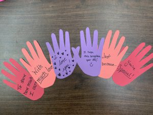 Paper hands craft project to express a message of love and caring.
