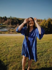 Female youth in blue dress