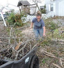 Youth in hurricane debris cleanup