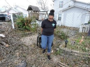 Youth cleaning up debris after Hurricane Michael