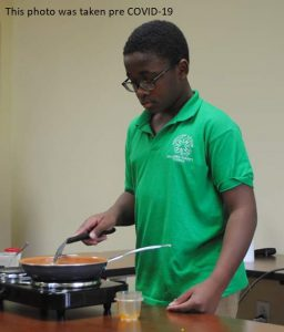 young man demonstrating how to cook a recipe