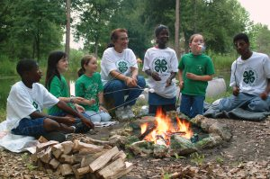 4-H youth around a campfire