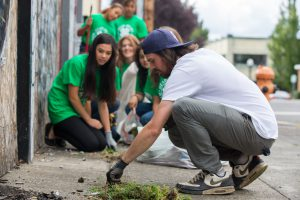 Youth and adults cleaning up their community