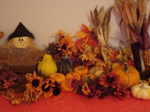 Favorite Fall Things: pumpkins, scarecrow, leaves, flowers, and multi-colored corn