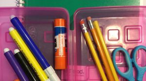 picture of pencil box with school supplies