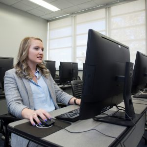 White female working in computer lab