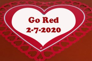 "Red words ""Go Red 2-7-2020"" inside white heart inside red paper heart"