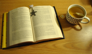 open book and cup of tea