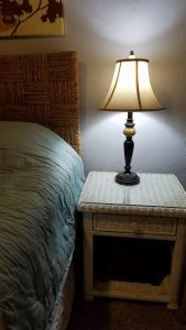 Image of nightstand with a lamp.