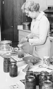 Woman canning in the kitchen.