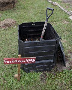 black compost bin and shovel