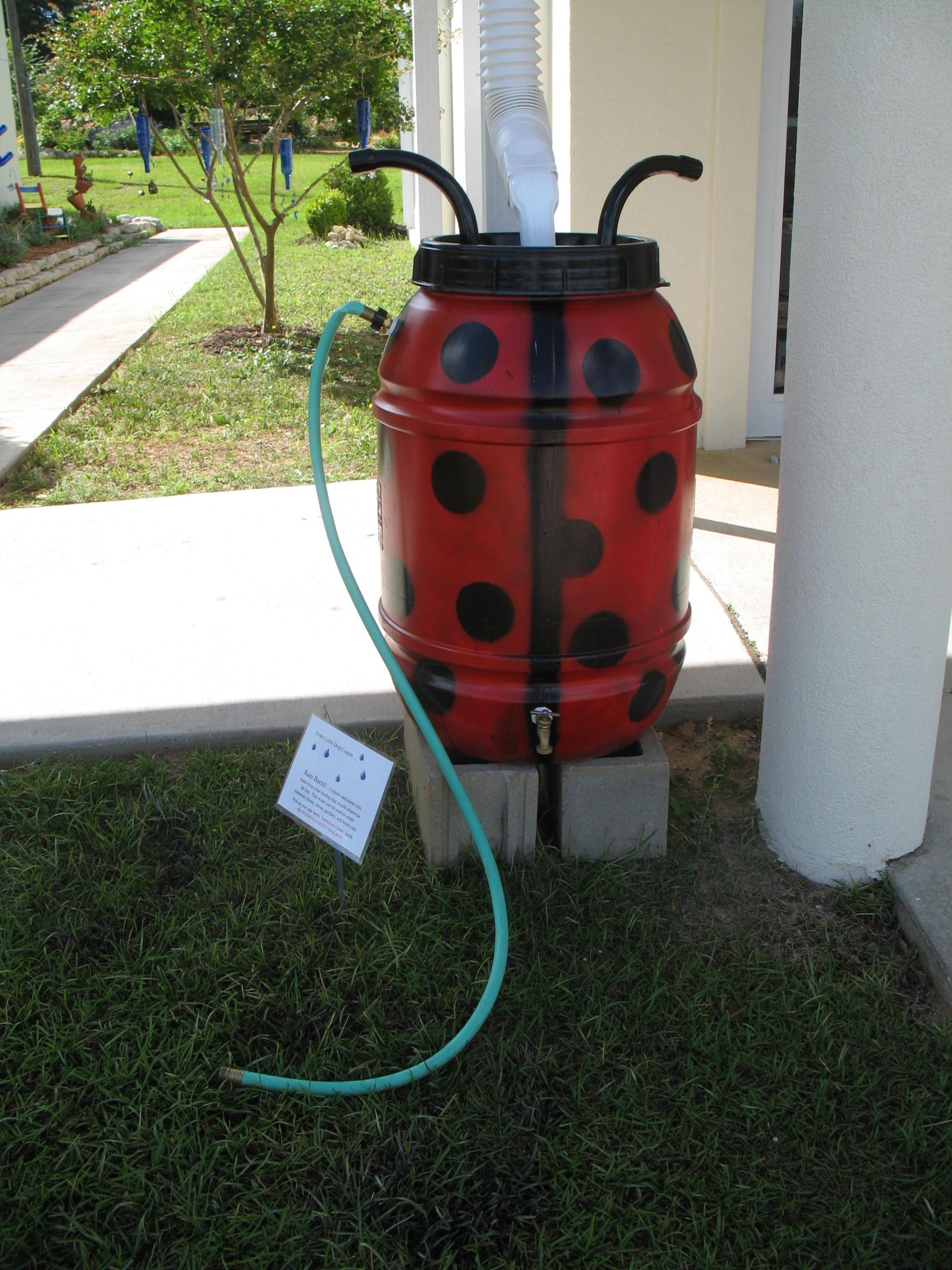 the first rain barrel i made was painted to look like a ladybug - Decorative Rain Barrels
