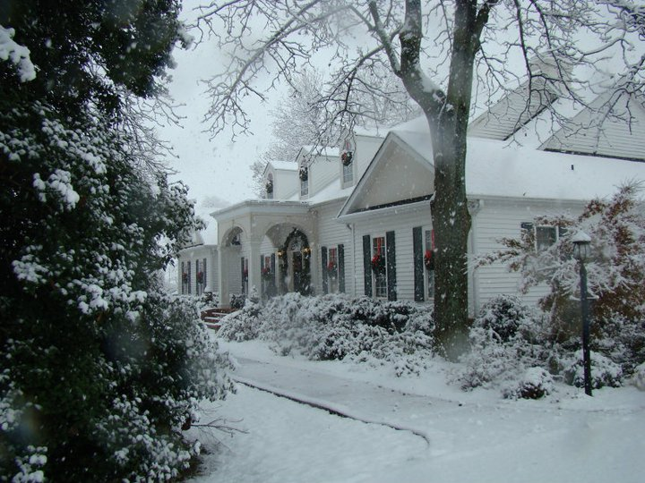 Wreaths and a decorated door frame add a bit of holiday cheer to this snowy scene. Photo courtesy Taylor Vandiver.