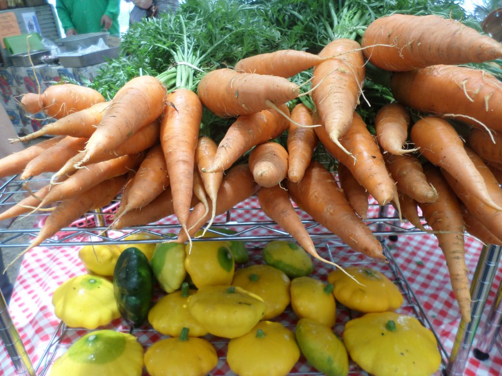 Carrots and squash at the Lake Ella Growers' Market. Photo by Jennifer Taylor.