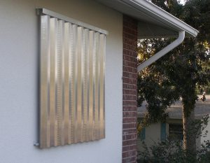 Aluminum shutters help protect windows from flying debris during windstorms.