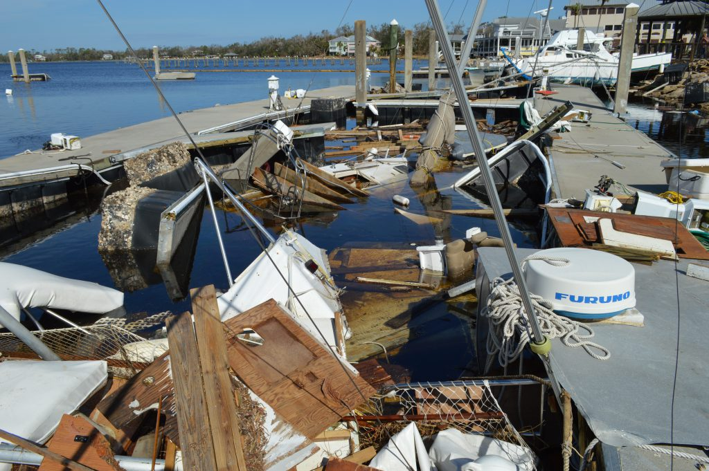 Fishery Disaster damage to marina docks and vessels after Hurricane Michael.