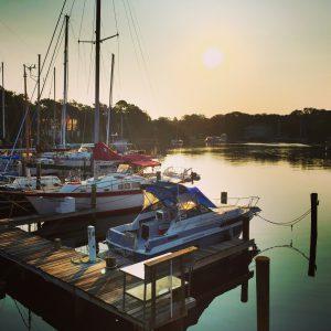 Boats at dock in harbor
