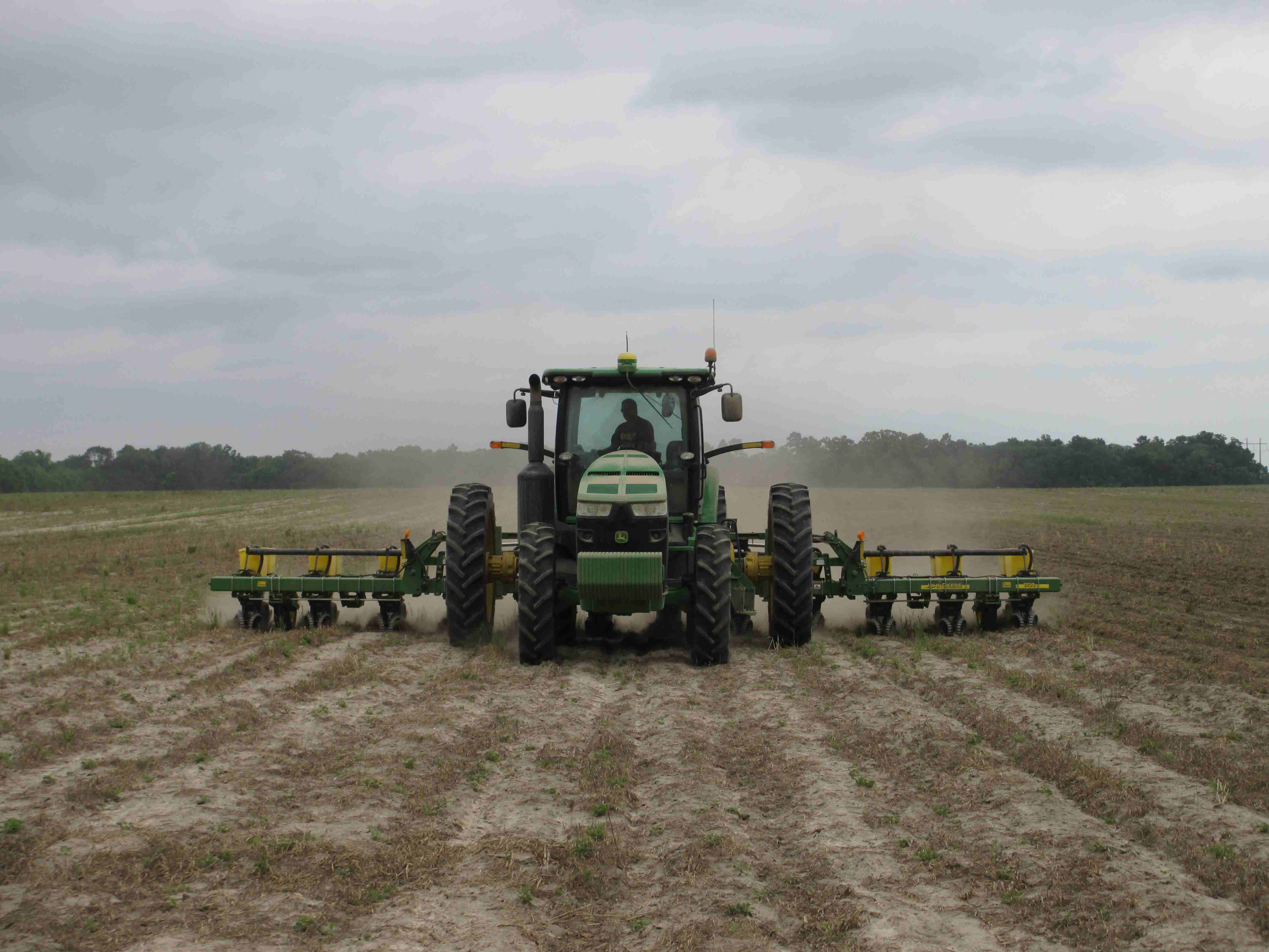 Planting cotton in Bacom, FL. Photo credit: J. Thompson