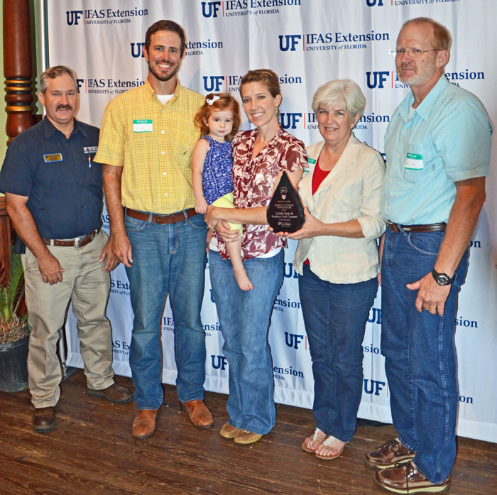 Doug Mayo, Jackson County Extension recognized Brad & Meghan Austin, and Cindy & Dale Eade as Agricultural Innovators in Jackson County.