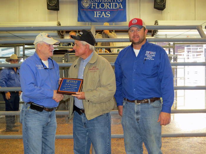 Steve Williams of J & W Simmental receiving his plaque for their consignment J&W Mr Cruising that was the winner of the FL Bull Test and SimAngus breed winner. Pictured (from L to R): Nick Comerford (NFREC Center Director), Steve Williams, and David Thomas (NFREC Beef Unit Supervisor).
