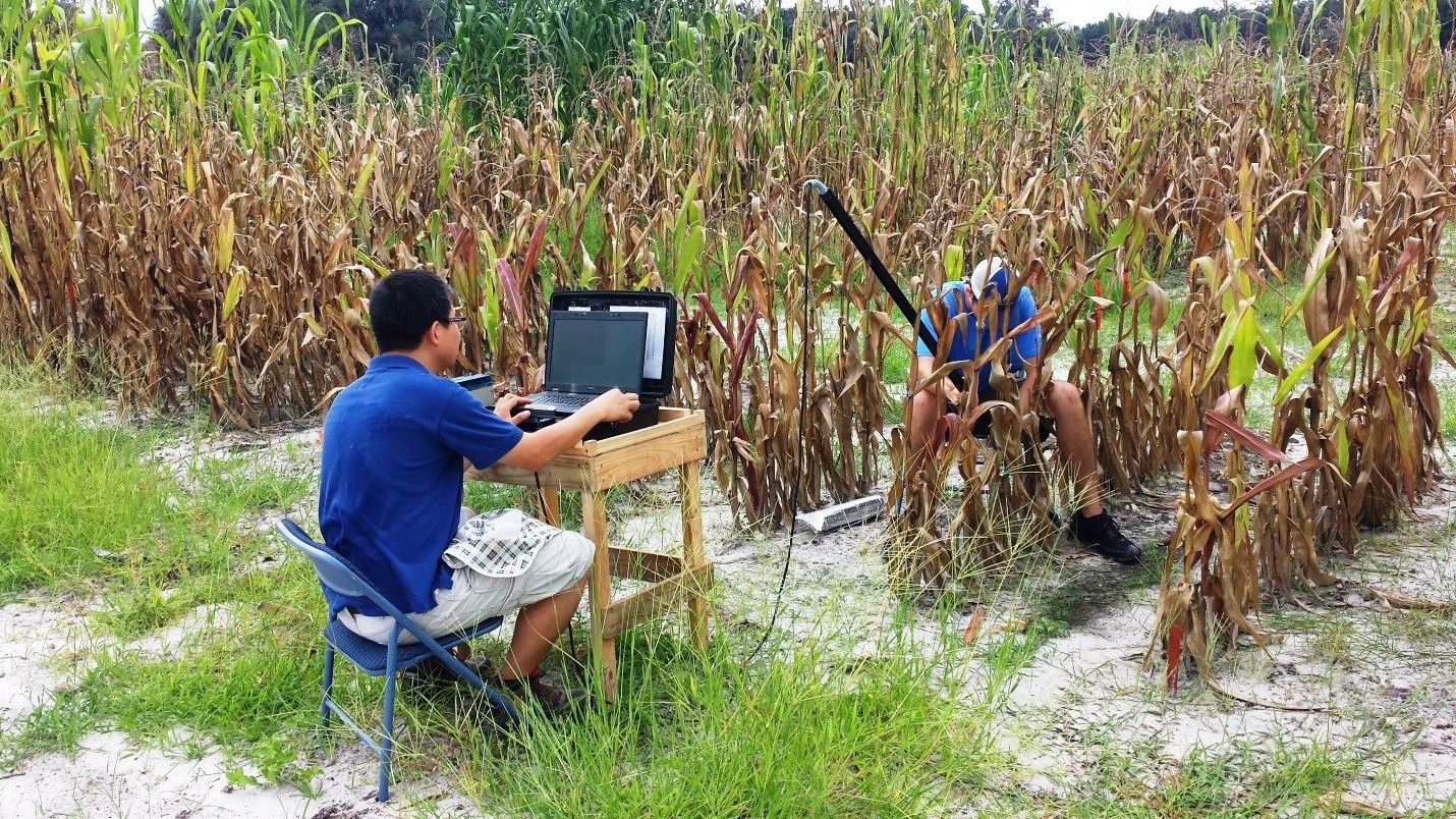 Figure 2. Root image is being captured; Dr. Na is monitoring captured images (left), Mr. Carter Lambert, a UF student, is inserting camera in to the tube accordingly (right).