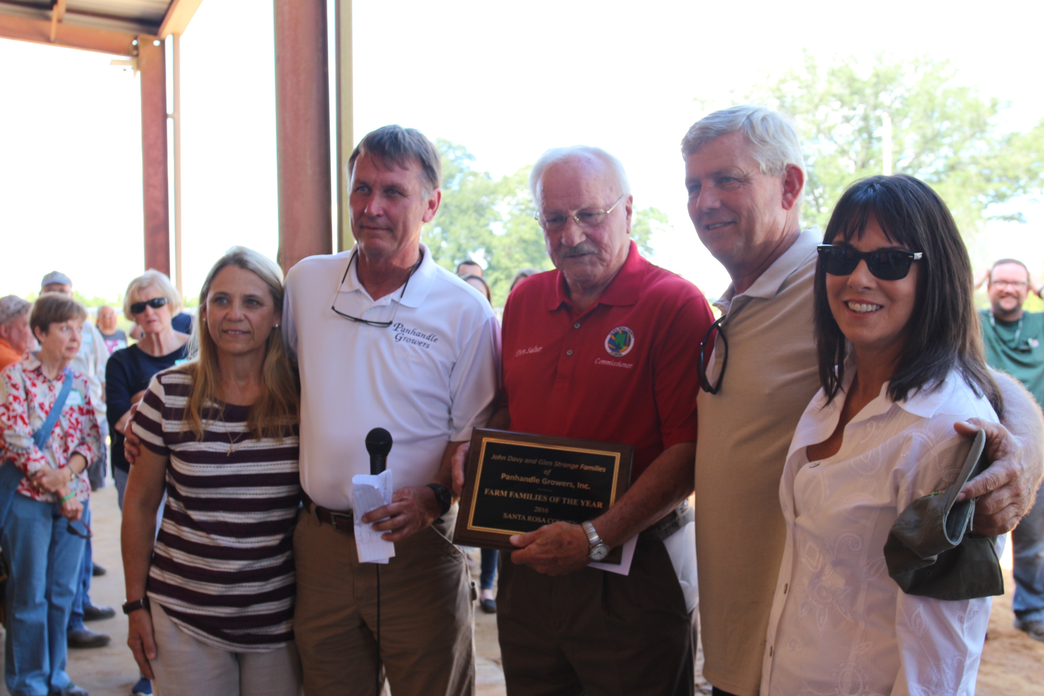 Glen and Janet Strange and John and Sara Davy accept 2016 Santa Rosa County Farm Families Award from County Commissioner Don Salter