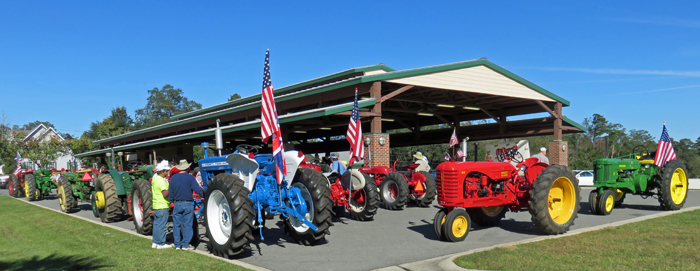Antique tractors on display at the Marianna Farmer's Market following the drive. Photo: Doug Mayo
