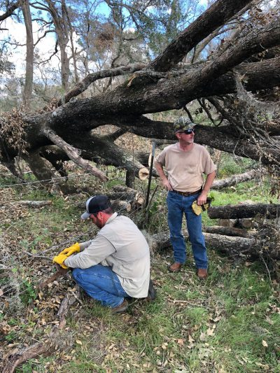 Extension agents and volunteers help producers repair fence damaged by Hurricane Michael