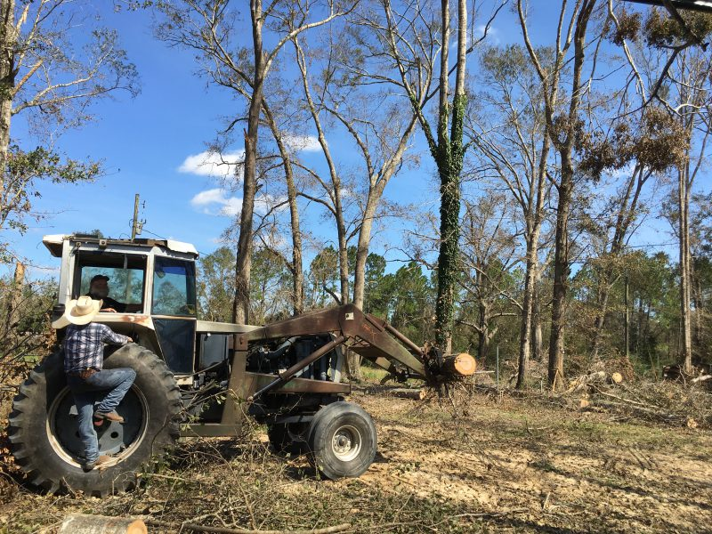 Tractor clearing debris