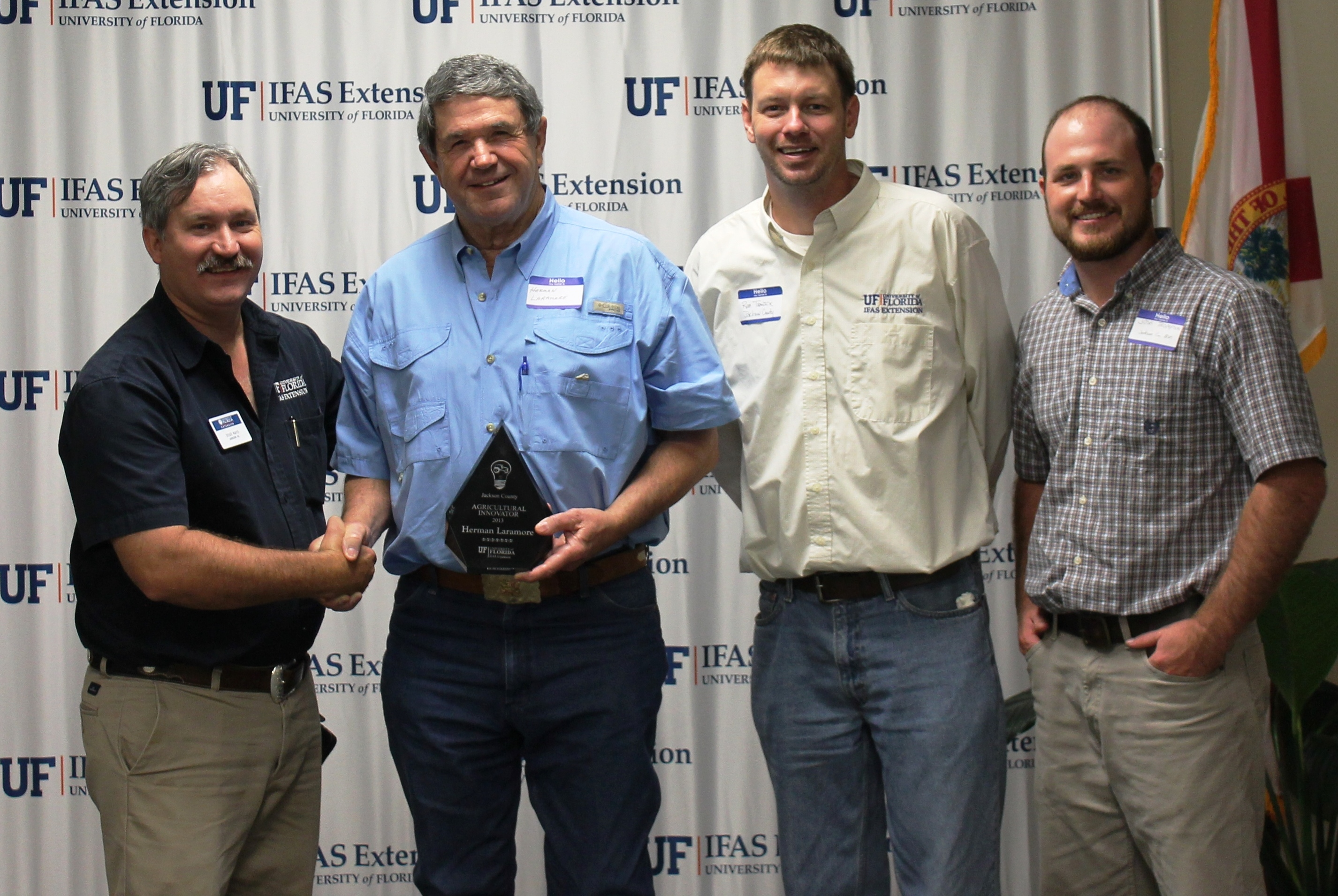 (From Left to Right) Jackson County Extension Director Doug Mayo, Herman Laramore, and Rob Trawick and Josh Thompson of Jackson County Extension